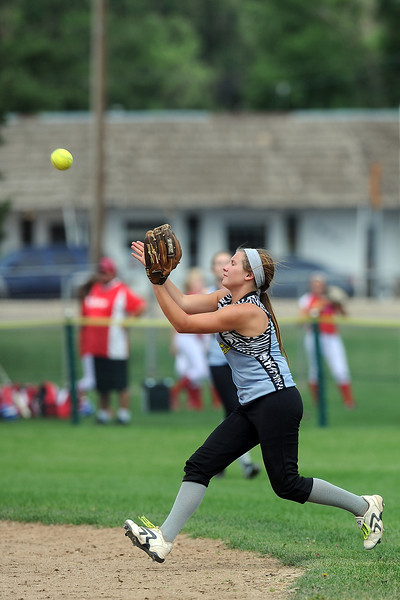 Loveland Classics center fielder Colissa Bakovich catches a fly ball during a game against the Lady Larks at the Barnes Softball Complex on Saturday, July 14, 2012.