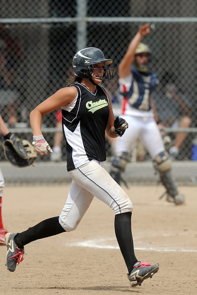 Colorado Classics player Cassidy Smith sprints to second base for a double in the bottom of the third inning of the USSSA championship game against the Warriors at the Barnes Softball Complex on Sunday, July 15, 2012.