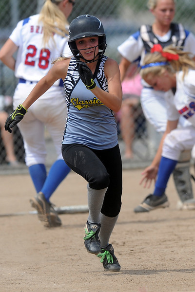 Loveland Classics' Kendall Johnson sprints to first base for a bunt single during a game against the Lady Larks at the Barnes Softball Complex on Saturday, July 14, 2012.