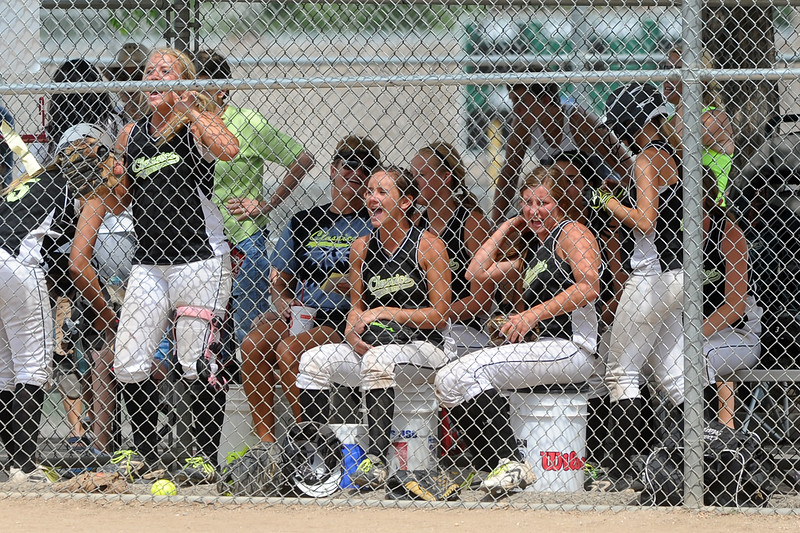 Colorado Classics players yell encouragement from the dugout during their USSSA championship game against the Warriors at the Barnes Softball Complex on Sunday, July 15, 2012.