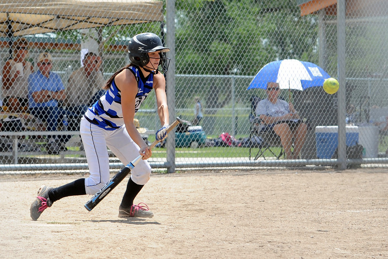 Loveland Rage player Kacey Uhlenbrock lays down a sacrifice bunt to advance a runner during a game against the Lakewood Tigers at the Barnes Softball Complex on Saturday, July 14, 2012.