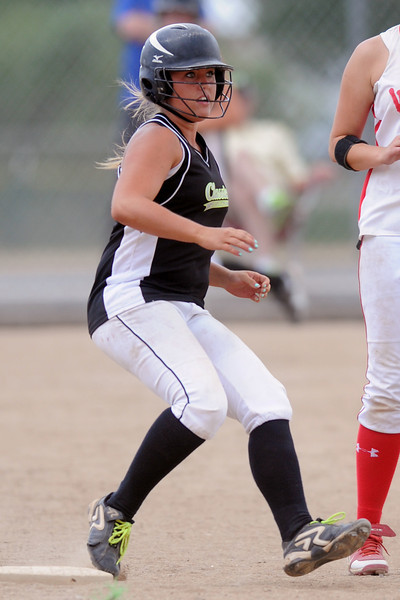 Colorado Classics' Alex Williams holds up at first base after hitting a single in the bottom of the fourth inning of a game against the Warriors for the USSSA championship at the Barnes Softball Complex on Sunday, July 15, 2012.