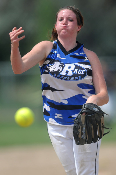 Loveland Rage's Janelle Krening throws a pitch during a game against the Lakewood Tigers at the Barnes Softball Complex on Saturday, July 14, 2012.