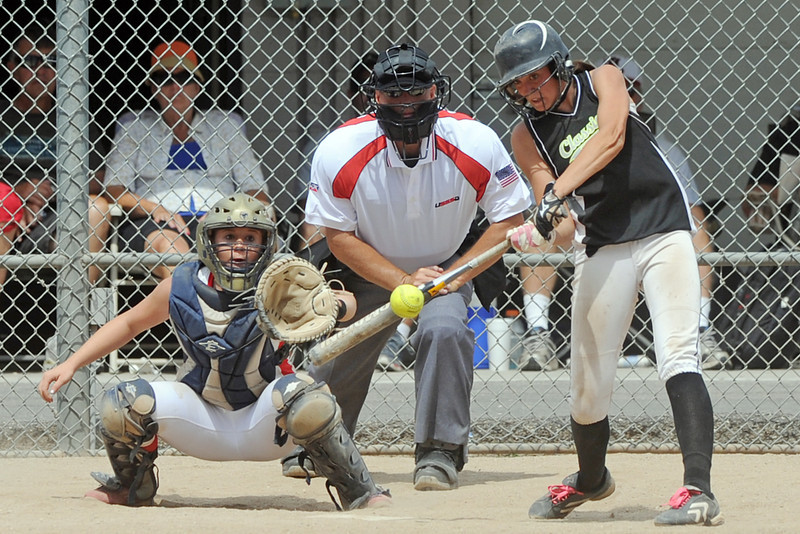 Colorado Classics batter Cassidy Smith hits a double in the bottom of the third inning in the USSSA championship game against the Warriors at the Barnes Softball Complex on Sunday, July 15, 2012.