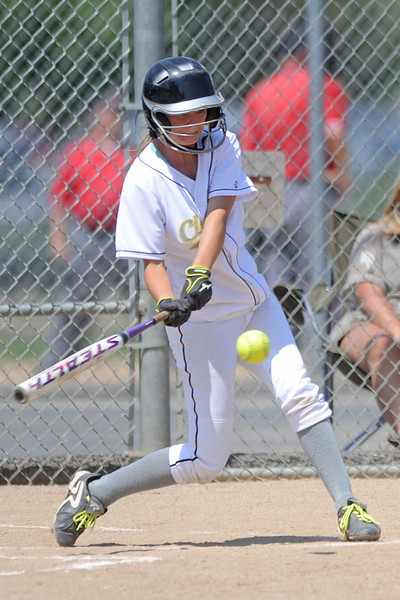 Chanley Burge of the Loveland Classic hits a single during a game against Majestix at the Barnes Softball Complex on Friday, July 13, 2012.