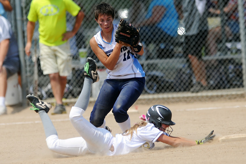 Colorado Classics baserunner Kendall Johnson slides safely into second base for a steal ahead of the tag by Majestix shortstop Erin Miller during their game at the Barnes Softball Complex on Friday, July 13, 2012.