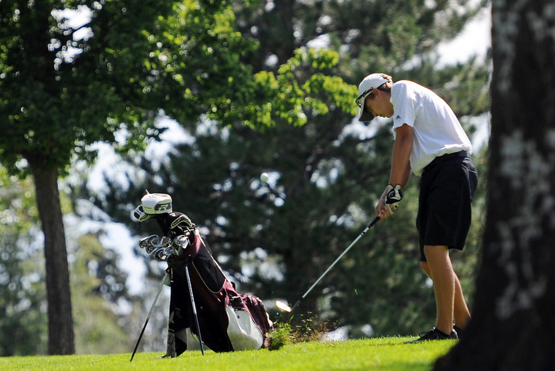 Berthoud's Shawn Solem hits a shot on No. 9 Mountain View's Matt Heesemann during the Class 4A Northern regional qualifier on Thursday, Sept. 19, 2013 at The Olde Course at Loveland. (Photo by Steve Stoner/Loveland Reporter-Herald)