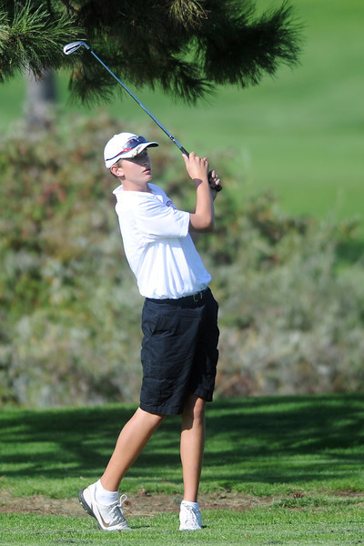 Berthoud's Joshua Schumacher watches his approach shot on No. 17  during the Class 4A Northern regional qualifier on Thursday, Sept. 19, 2013 at The Olde Course at Loveland. (Photo by Steve Stoner/Loveland Reporter-Herald)