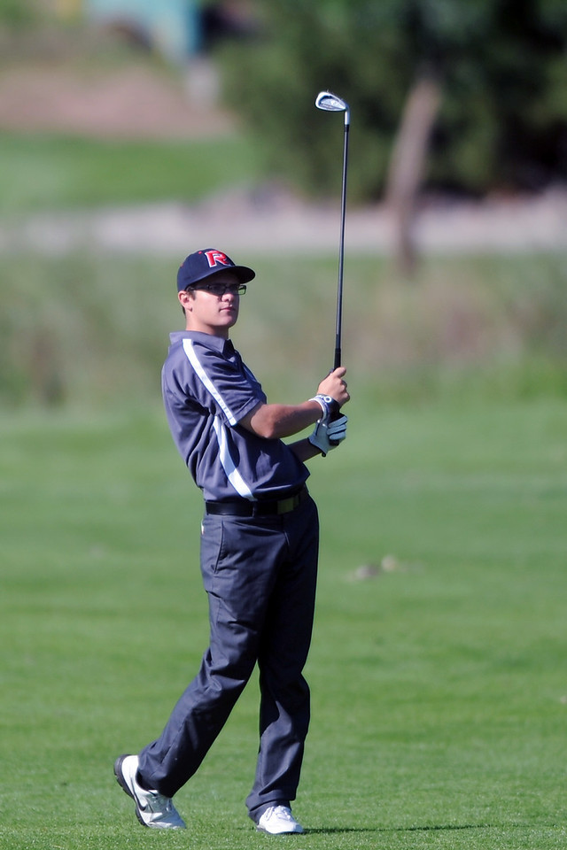 Roosevelt's Zak King watches his approach shot on No. 15 during the Class 4A Northern regional qualifier on Thursday, Sept. 19, 2013 at The Olde Course at Loveland. (Photo by Steve Stoner/Loveland Reporter-Herald)