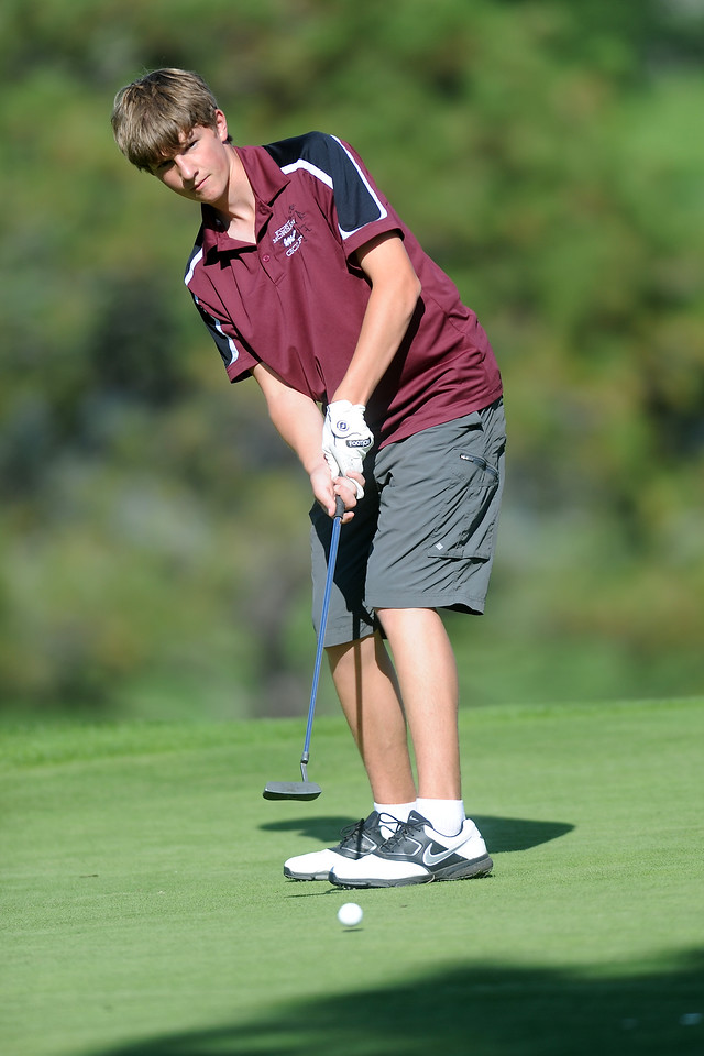 Fort Morgan High School sophomore Jack Farley watches his putt on No. 15 during the Class 4A Northern regional qualifier on Thursday, Sept. 19, 2013 at The Olde Course at Loveland. (Photo by Steve Stoner/Loveland Reporter-Herald)