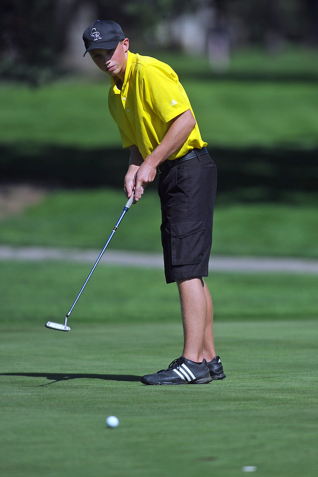 Thompson Valley's Alex Liss watches his putt on No. 16 during the Class 4A Northern regional qualifier on Thursday, Sept. 19, 2013 at The Olde Course at Loveland. (Photo by Steve Stoner/Loveland Reporter-Herald)