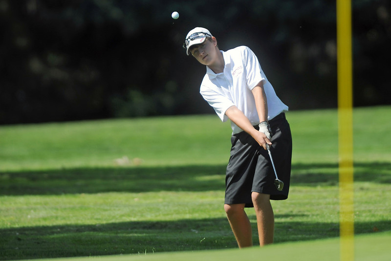Berthoud's Shawn Solem chips onto No. 12 during the Class 4A Northern regional qualifier on Thursday, Sept. 19, 2013 at The Olde Course at Loveland. (Photo by Steve Stoner/Loveland Reporter-Herald)(Photo by Steve Stoner/Loveland Reporter-Herald)