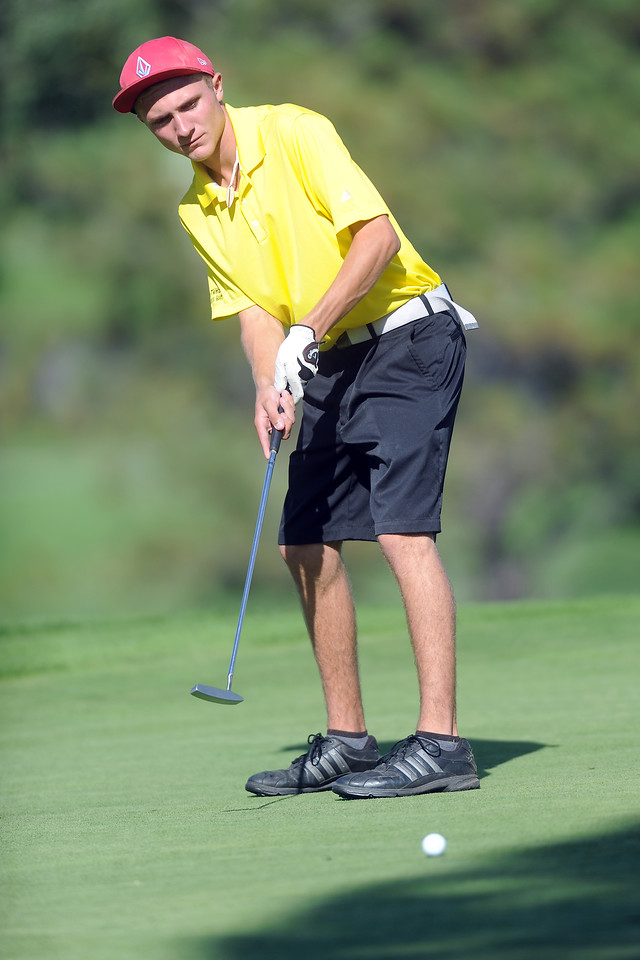 Thompson Valley's Trevor Dean watches his putt on No. 15 Fort Morgan High School sophomore Jack Farley watches his putt on No. 15 during the Class 4A Northern regional qualifier on Thursday, Sept. 19, 2013 at The Olde Course at Loveland. (Photo by Steve Stoner/Loveland Reporter-Herald)