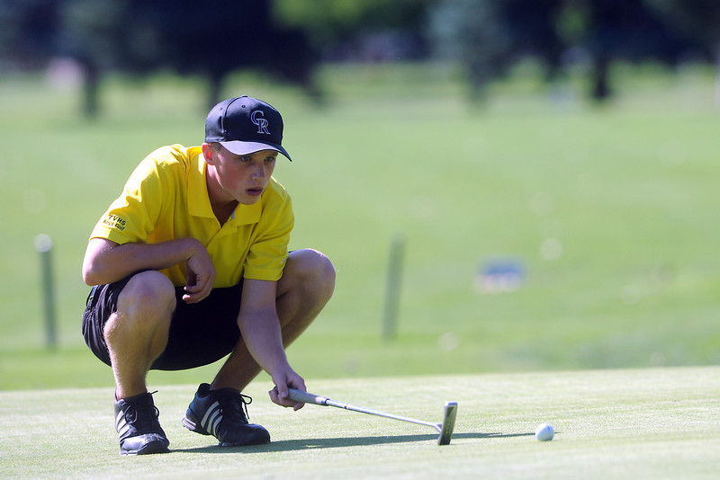 Thompson Valley's Alex Liss checks the line on his putt on No. 18 during the Class 4A Northern regional qualifier on Thursday, Sept. 19, 2013 at The Olde Course at Loveland. (Photo by Steve Stoner/Loveland Reporter-Herald)