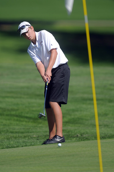 Berthoud's Shawn Solem putts from the fringe on No. 13 during the Class 4A Northern regional qualifier on Thursday, Sept. 19, 2013 at The Olde Course at Loveland. (Photo by Steve Stoner/Loveland Reporter-Herald)