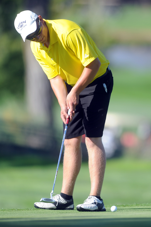 Thompson Valley's Hayden Trimble putts on No. 17  during the Class 4A Northern regional qualifier on Thursday, Sept. 19, 2013 at The Olde Course at Loveland. (Photo by Steve Stoner/Loveland Reporter-Herald)