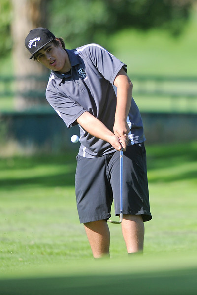 Roosevelt's Justice Gonzales hits a chip shot during the Class 4A Northern regional qualifier on Thursday, Sept. 19, 2013 at The Olde Course at Loveland. (Photo by Steve Stoner/Loveland Reporter-Herald)