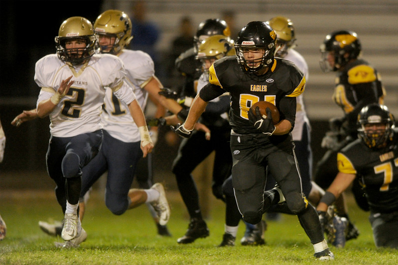 Matt Berg (81), center, running back for Thompson Valley, runs for a touchdown from midfield in the first half against Greeley West on Friday, Oct. 23, 2015 in Loveland. (Photo by Trevor L Davis/Loveland Reporter-Herald)