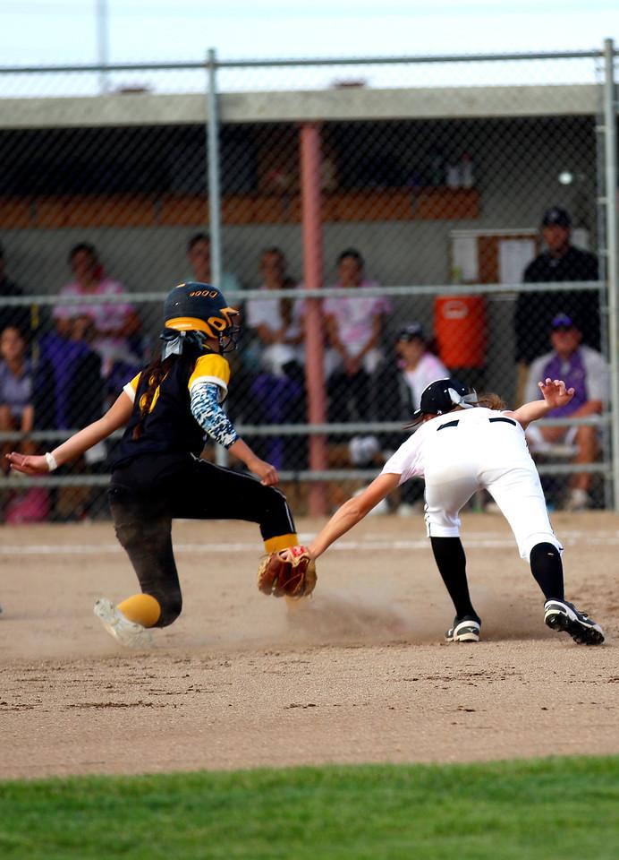 The Lady Eagles Janessa Rivera beats the tag. (Photo by Matthew Gaston/ Loveland Reporter- Herald)