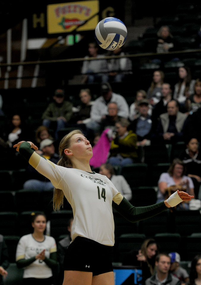 Alexandra Poletto (14), middle blocker for Colorado State, serves the ball in the second game against San Diego State on Thursday, Oct. 29, 2015 in Fort Collins. Colorado State won the match in three games, (Photo by Trevor L. Davis/Loveland Reporter-Herald)