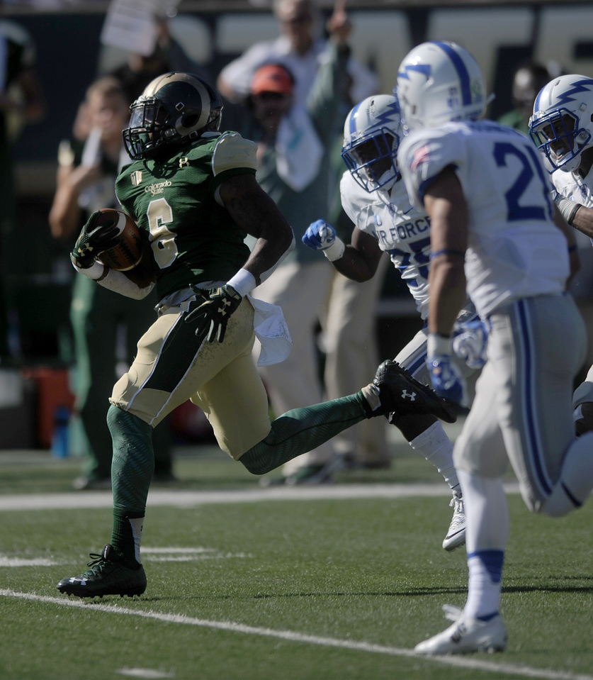 Jasen Oden Jr. (6), running back for Colorado State, runs for a first down against in the first half against Air Force on Saturday, Oct. 17, 2015 in Fort Collins. (Photo by Trevor L Davis/Loveland Reporter-Herald)