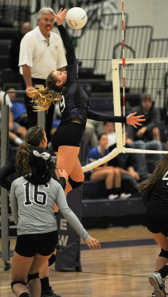 Olivia Smith spikes the ball Tuesday night against Longmont. (Photo by Matthew Gaston/ Loveland Reporter- Herald)