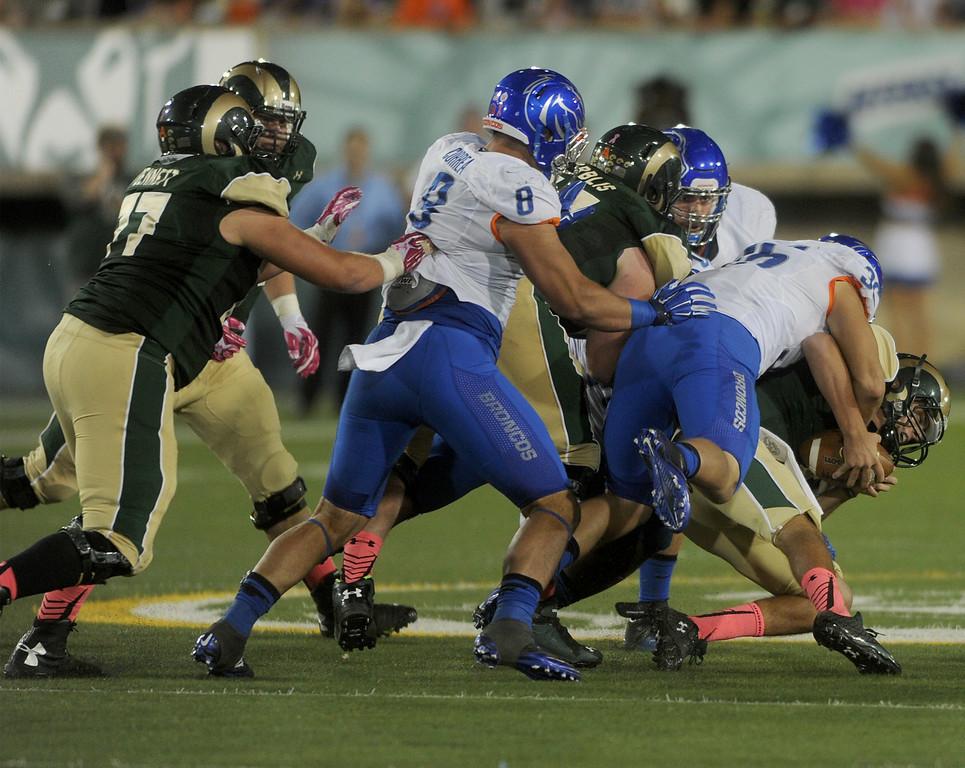 Tyler Gray (36), linebacker for Boise State, sacks Nick Stevens (7), quarterback for Colorado State on Saturday, Oct. 10, 2015 in Fort Collins.(Photo by Trevor L Davis/Loveland Reporter-Herald)