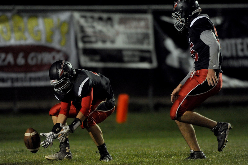 Dane Abila (44), left, linebacker for Loveland High, recovers a blocked kick by his team mate Zack Swartwout (55), right, defensive lineman, on Friday, Oct. 16, 2015 in Loveland. (Photo by Trevor L Davis/Loveland Reporter-Herald)