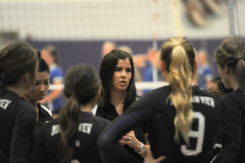 Head Coach Kaitlyn Schiffelbein gives her team encouragement at Tuesday nights game. (Photo by Matthew Gaston/ Loveland Reporter-Herald)