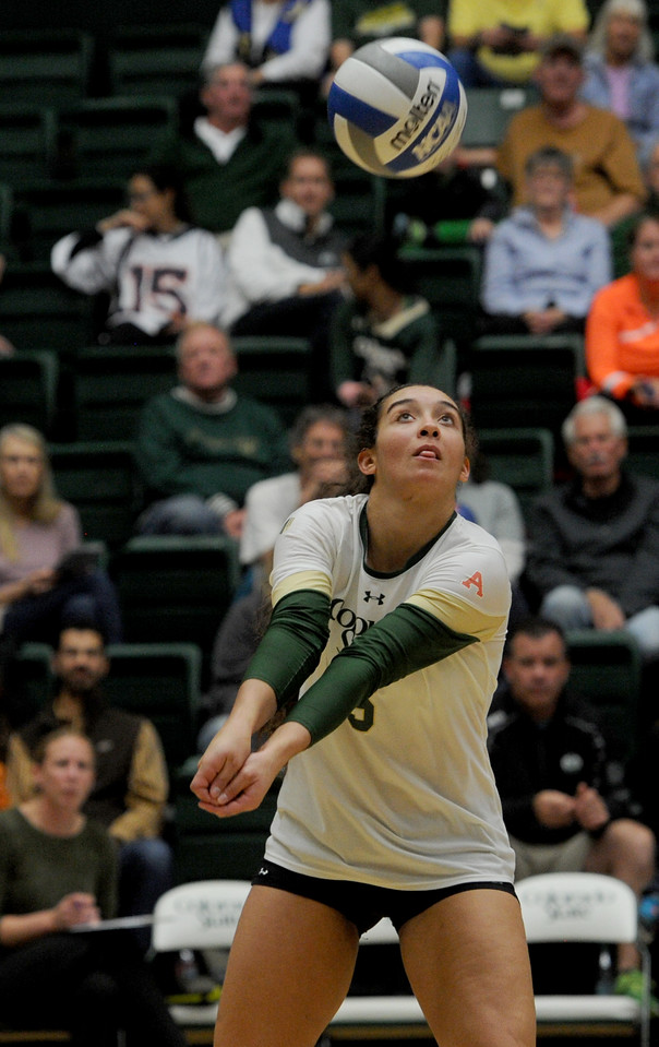 Alex Reid (5), outside hitter for Colorado State, does a dig against San Diego State on Thursday, Oct. 29, 2015 in Fort Collins. (Photo by Trevor L. Davis/Loveland Reporter-Herald)