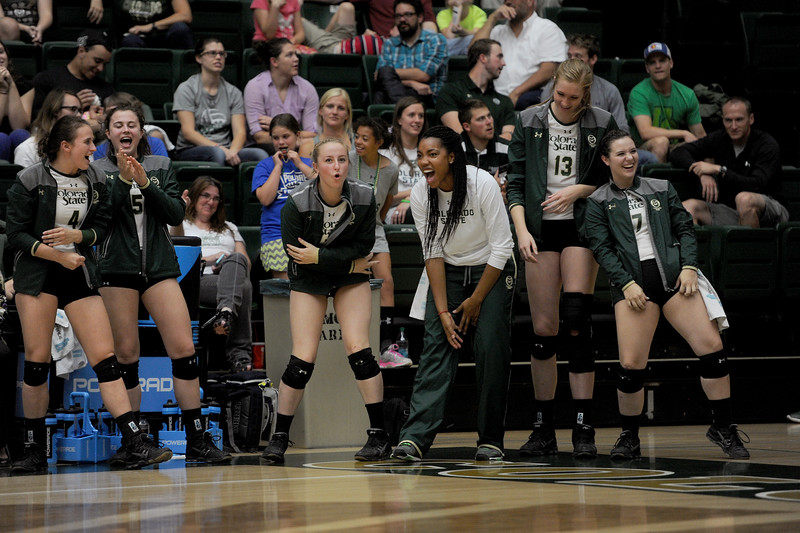 From Left to right, Grace Gordon (4), Alex Reid (5), Katie Craig (7), Jessica Jackson (21), Kirstie  Hillyer (13) and Mariah Green (17), Colorado State volleyball players, cheer their team on during the last set against the Wyoming Cowgirls on Tuesday, Oct. 13, 2015 in Fort Collins. The Rams won in three sets. (Photo by Trevor L Davis/Loveland Reporter-Herald)