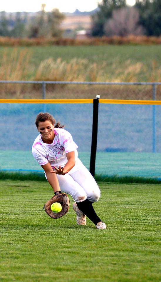 The Mountain Lions right fielder Kelsey Vreeman, fields a hit at Thursdays game against Thompson Valley. (Photo by Matthew Gaston/ Loveland Reporter- Herald)