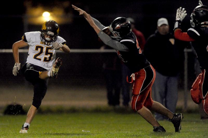 Gunner Mengel (25), punter for Thompson Valley, gets his kick blocked by Zack Swartwout (55), defensive lineman for Loveland High, on Friday, Oct. 16 2015 in Loveland. (Photo by Trevor L Davis/Loveland Reporter-Herald)