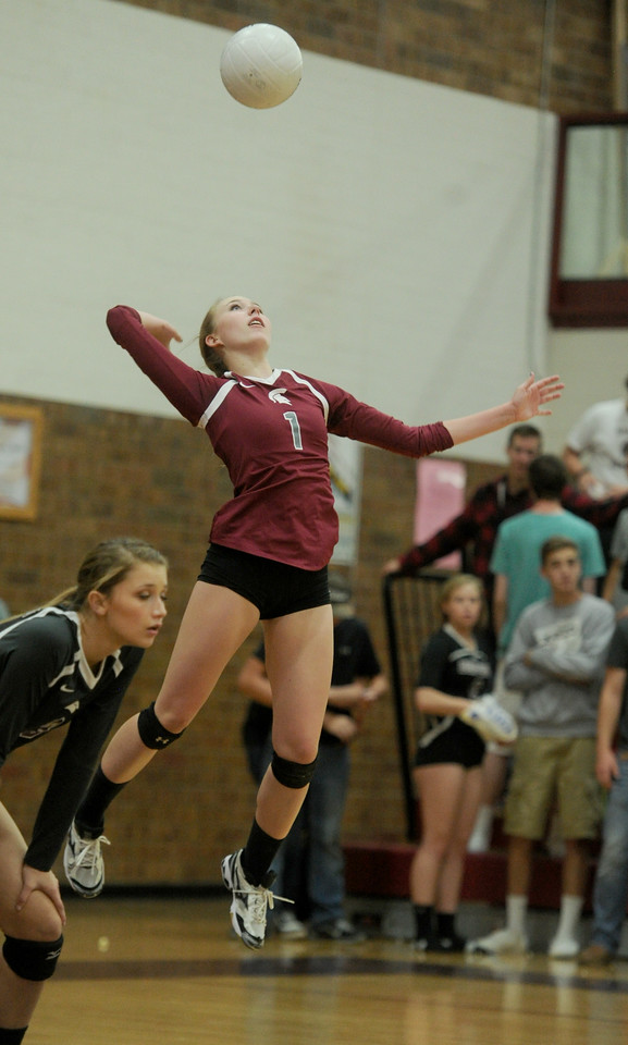 Haley Hummel (1), senior at Berthoud High, serves the ball in the team's third set against Frederick High on Tuesday, Oct. 20, 2015 in Berthoud. (Photo by Trevor L Davis/Loveland Reporter-Herald)