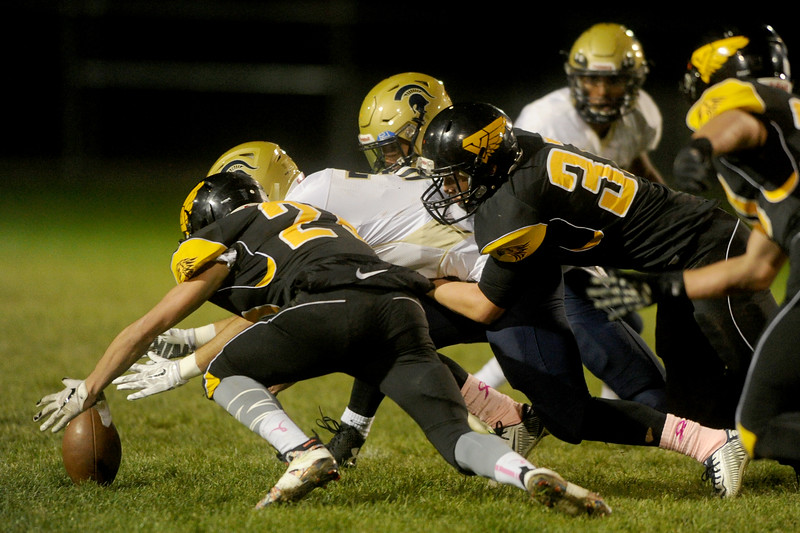 Gunner Mengel (25), right, free safety for Thompson Valley, recovers a fumble in the first half against Greeley West on Friday, Oct. 23, 2015 in Loveland. (Photo by Trevor L Davis/Loveland Reporter-Herald)