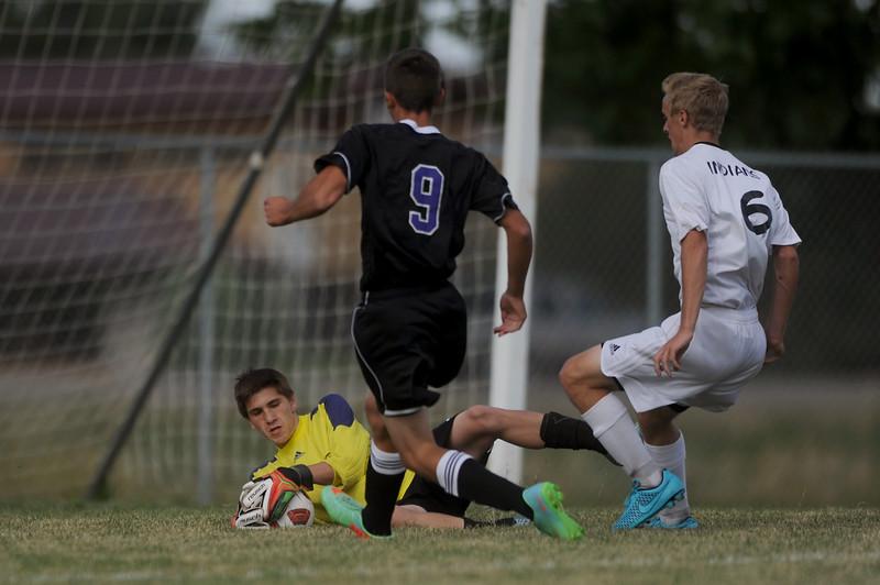 Loveland High's, Trent Whittaker makes a save against Mountain View's, Jeramy Gordon on Sept. 10, 2015. (Photo by Trevor L Davis/Loveland Reporter-Herald)