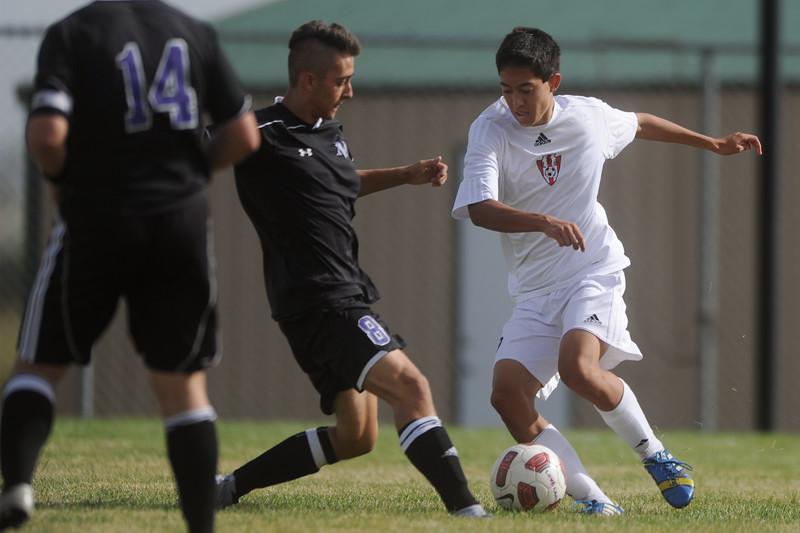 Mountain View's, Spencer Condon and, Loveland High's, Josh Stackhouse fight for the ball on Sept. 10, 2015. (Photo by Trevor L Davis/Loveland Reporter-Herald)
