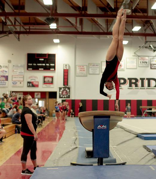 Loveland High's, Shaylee Johnson bounces off the vault in a gymnastics event at LHS on Sept. 11, 2015 in Loveland. (Photo by Trevor L Davis/Loveland Reporter-Herald)