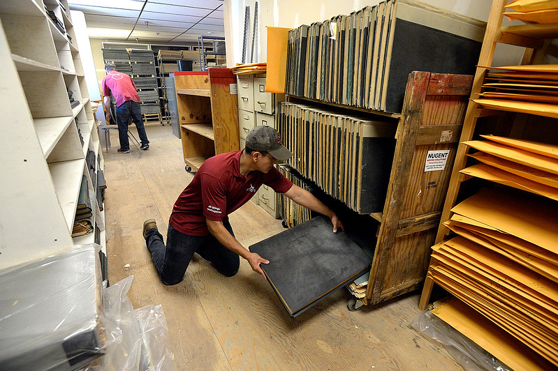 Juan Ornelas with Workspace Innovations works with a crew to pack up and move the Reporter-Herald newspaper archives Thursday, June 8, 2017, in downtown Loveland. The Loveland Museum/Gallery will take over the 127 year-old archives. (Photo by Jenny Sparks/Loveland Reporter-Herald)