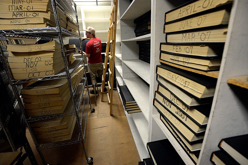 Jared Bos with Workspace Innovations works with a crew to pack up the Reporter-Herald newspaper archives Thursday, June 8, 2017, in downtown Loveland. The Loveland Museum/Gallery will take over the 127 year-old archives. (Photo by Jenny Sparks/Loveland Reporter-Herald)