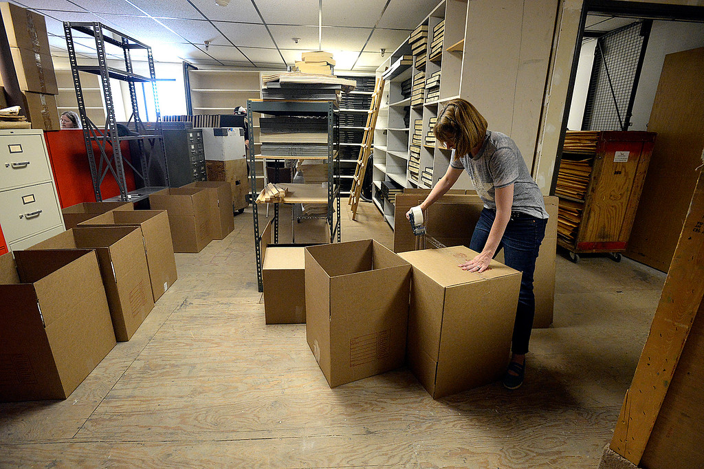 . Jennifer Cousino, curator of history for the Loveland Musem/Gallery, packs up the Reporter-Herald newspaper archives Thursday, June 8, 2017, in downtown Loveland. The Loveland Museum/Gallery will take over the 127 year-old archives. (Photo by Jenny Sparks/Loveland Reporter-Herald)