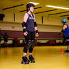 Paige Lewis takes part in the Baystate Brawlers roller derby new skater class at Roll-On America on Wednesday. SENTINEL & ENTERPRISE / Ashley Gree