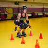 InstructorMaggie Lavalle demonstrates for the class during the Baystate Brawlers roller derby new skater class at Roll-On America on Wednesday. SENTINEL & ENTERPRISE / Ashley Gree