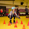 Grace McCurn takes part in the Baystate Brawlers roller derby new skater class at Roll-On America on Wednesday. SENTINEL & ENTERPRISE / Ashley Gree