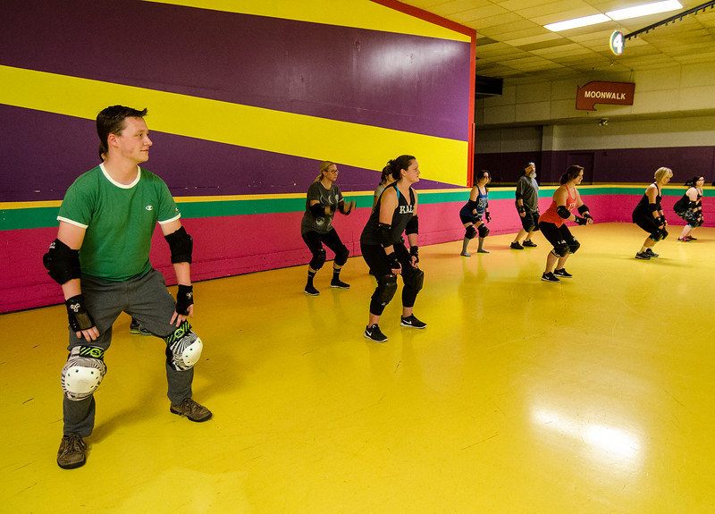 Sentinel & Enterprise reporter Peter Jasinski learns how to fall safely during the Baystate Brawlers roller derby new skater class at Roll-On America on Wednesday. SENTINEL & ENTERPRISE / Ashley Green