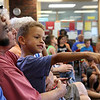 Donna Phillips from the Museum of Science in Boston brought three reptiles to the Fitchburg Public Library for the kids to see. Steve Moran Jr., 5, of Leominster was surprised to she a prehensile tail skink during Phillips show at the library on Thursday. SENTINEL & ENTERPRISE/JOHN LOVE