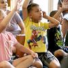 Donna Phillips from the Museum of Science in Boston brought three reptiles to the Fitchburg Public Library for the kids to see. Benjamin Bolduc, 6, from Fitchburg was eager to ask a question about the eastern milk snake that Phillips brought to show the kids. SENTINEL & ENTERPRISE/JOHN LOVE
