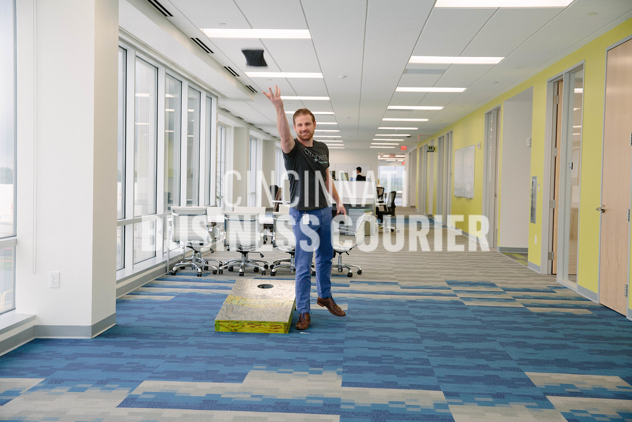 Kevin Reiley, Business Analytics Manager, takes a break to play corn hole in the break area at Quotient in the new Kenwood Collection building on Friday September 30 2016 in Cincinnati, OH. (Josh Anderson for Cincinnati Business Courier)