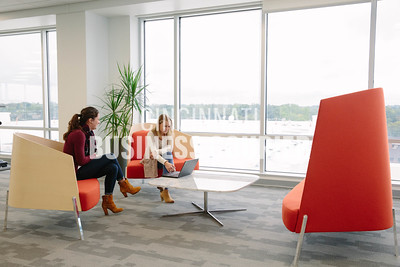 Allison Rieskamp, and Emily Smith take a meeting at a small sitting area at Quotient in the new Kenwood Collection building on Friday September 30 2016 in Cincinnati, OH. (Josh Anderson for Cincinnati Business Courier)