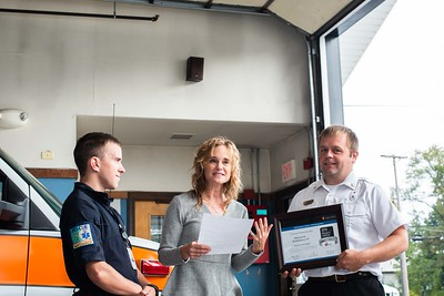Sarah Duzinski, Director of Quality & Systems Improvement for the American Heart Association in Austin, TX, presents the Silver Plus Mission Lifeline Achievement Award to Rescue Inc. on Thursday, September 26th.  Pictured with Sarah are Paramedic, Jeff Frizzell (left) and Chief, Drew Hazelton (right) (photo:  Kelly Fletcher)